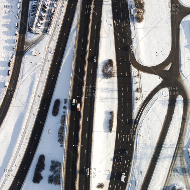 Cars on a multi-lane highway in the snow