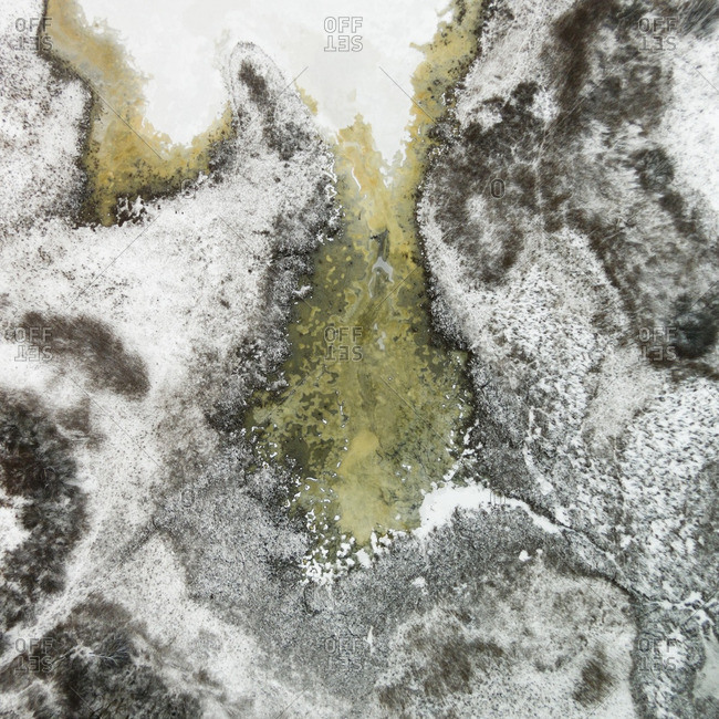 Ice and sediment in a frozen pond