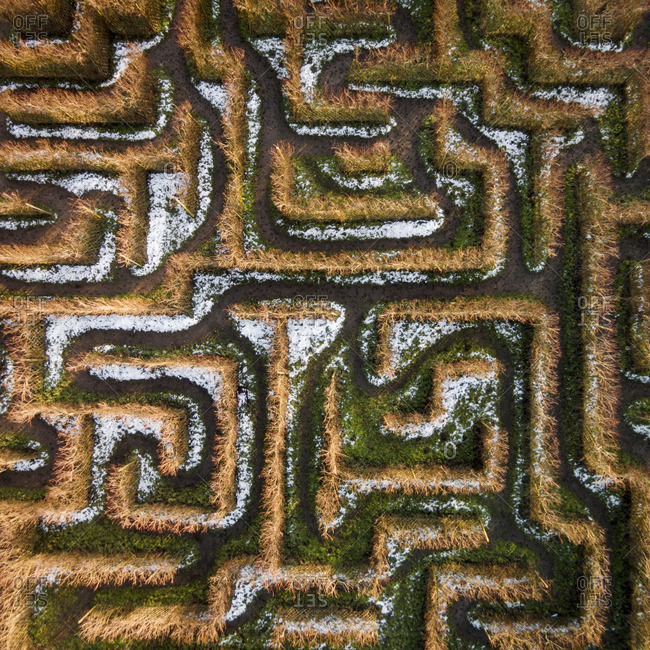 Snow dusting the paths of a maze in a field in Lithuania