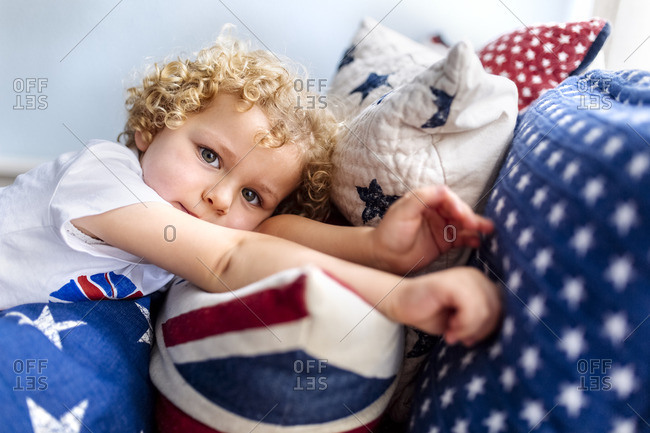 Portrait of blond little boy relaxing at home