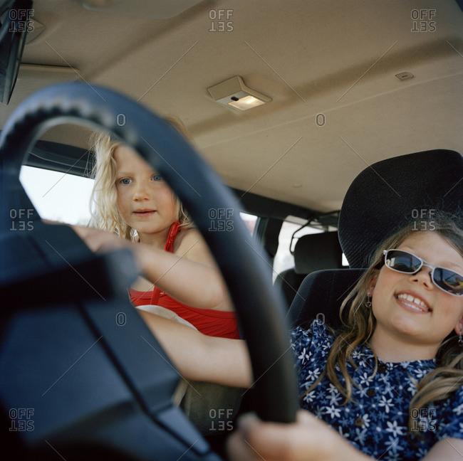 Scandinavian girls playing in a car