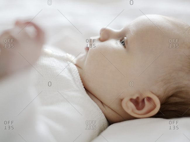 Close up of a baby lying down