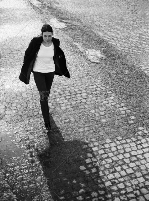 A young Scandinavian woman walking on the street