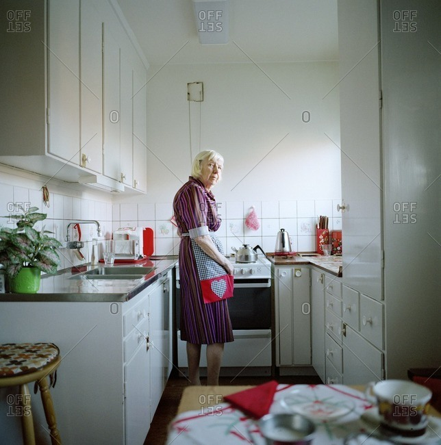 A elderly woman in a kitchen