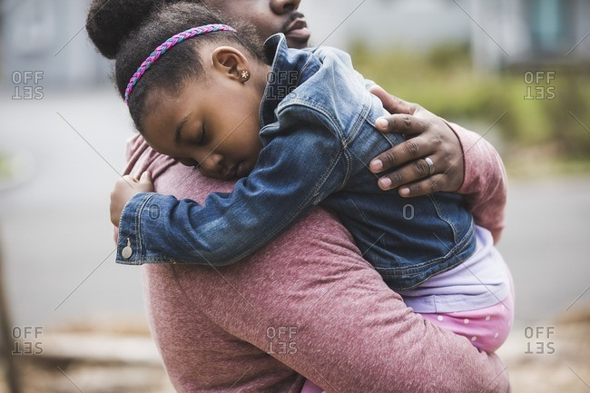 Father holding and hugging daughter