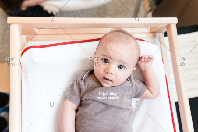 Overhead view of baby on changing table