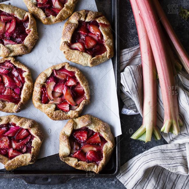 A tray of strawberry rhubarb galettes