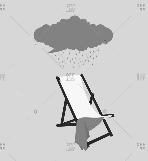 Rain cloud above a beach chair