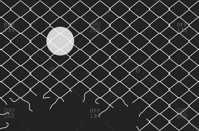 Night sky behind broken chain link fence