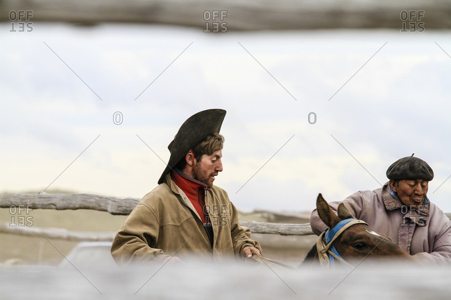 January 18, 2010: Gauchos working on horseback in Chubut Province, Argentina
