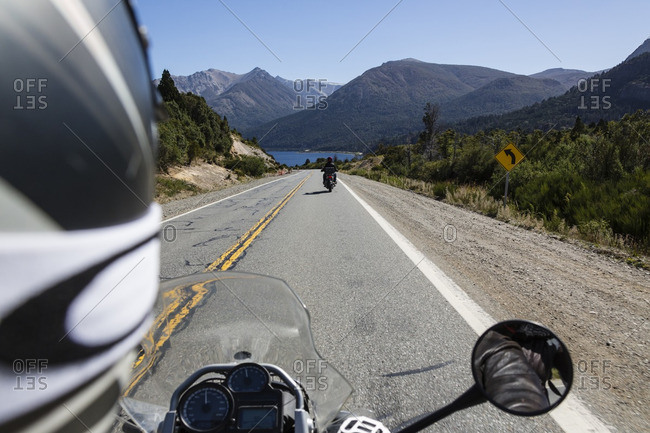 Motorcyclists on a road trip in Nahuel Huapi National Park, Argentina