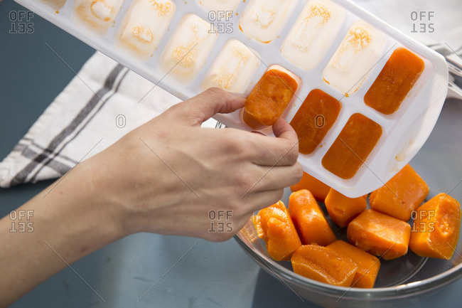 Homemade baby food frozen in an ice cube tray