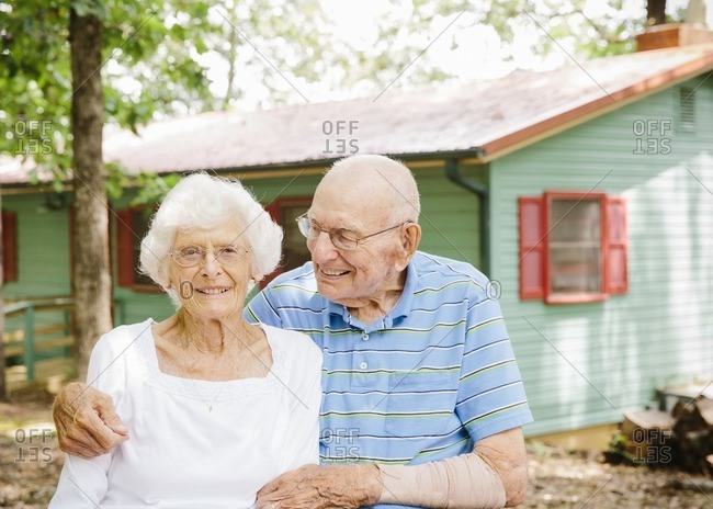 Portrait of a senior couple in front of a cabin