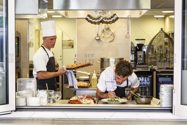 Hornbaek, Denmark - July 3, 2015: Chef saucing food at Ilse Jacobsens Kurbadet restaurant