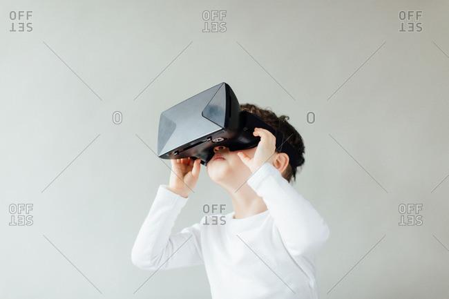 Boy using virtual reality headset