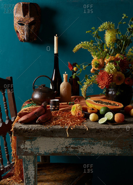 Still life Mexican Day of the Dead rustic  Dutch masters theme with red bananas, apricot, lime and papaya