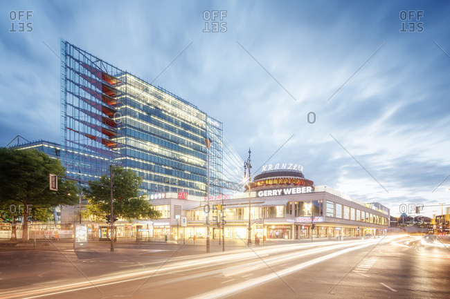 Berlin, Germany - May 18, 2016: Busy city street and Cafe Kranzler at an intersection in Berlin at dusk