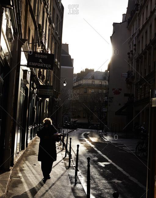February 8, 2015: Woman in sunlight Parisian street