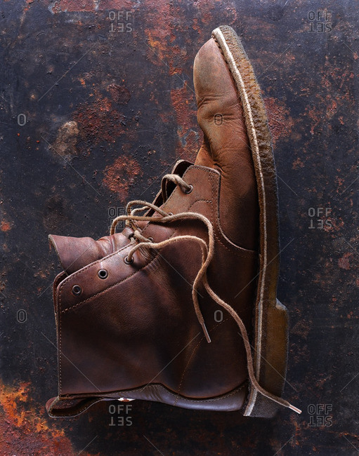 A single brown leather shoe