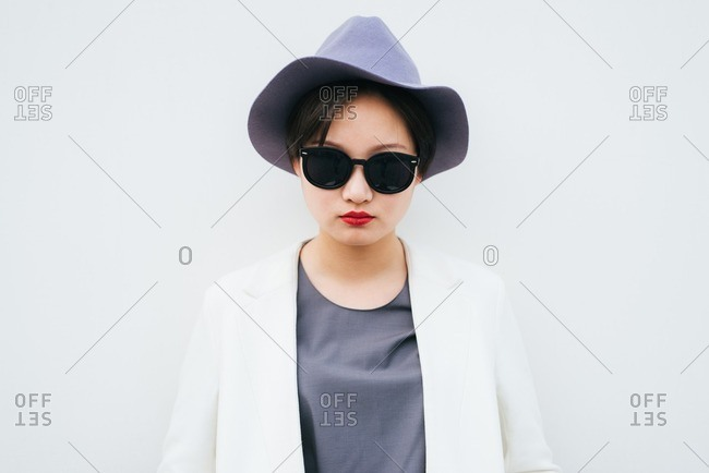 Fashionable young woman with gray hat and red lips