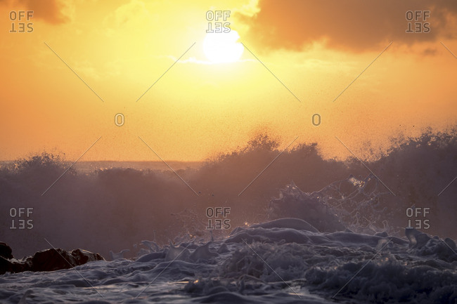 Waves churning at a seashore at sunrise