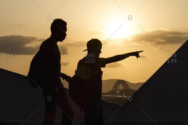 Panama City, Panama - February 22, 2016: Two young men walking near the Bridge of the Americas