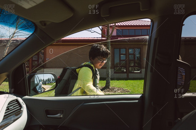 Boy getting in vehicle after school