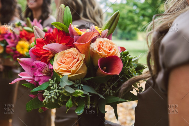 Bridesmaids holding colorful bouquets