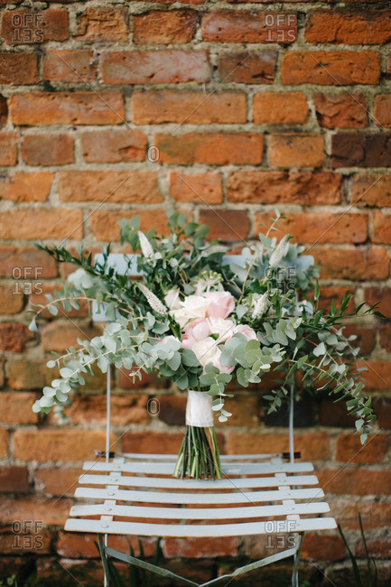 Wedding bouquet on a folding chair