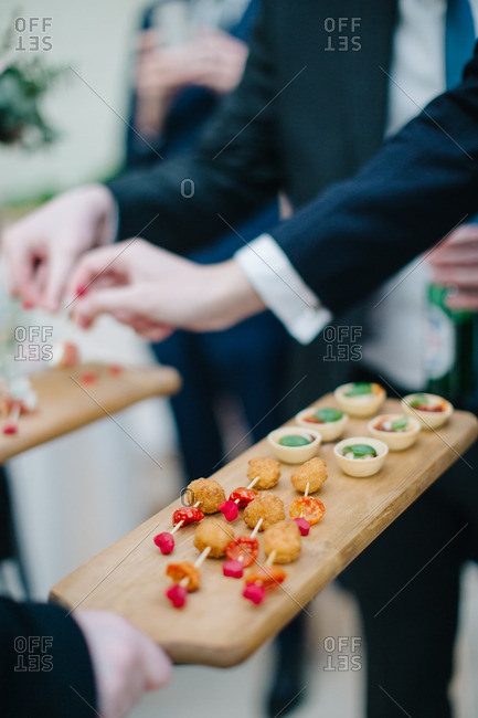 Guests sampling hors doeuvres at a wedding reception