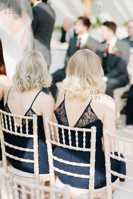 Bridesmaids and groomsmen sitting outside at wedding reception