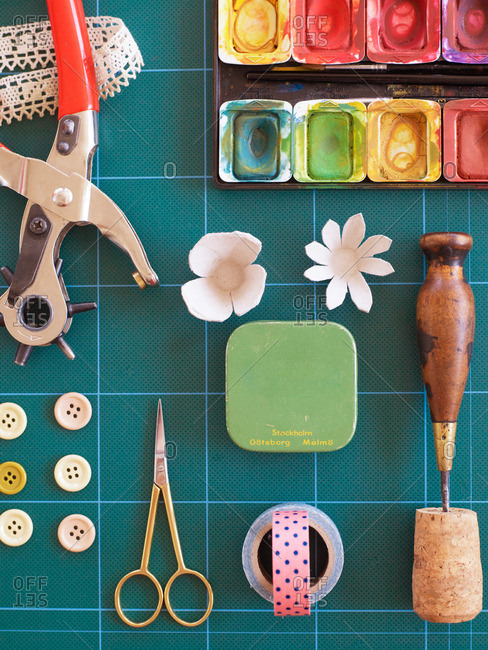 Close-up view of a crafting mat covered with various crafting tools