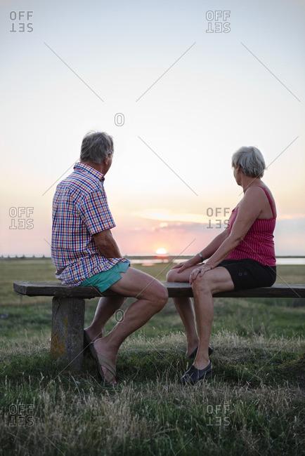 Senior couple looking at sunset