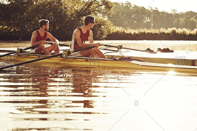 Young men canoeing - Offset Collection