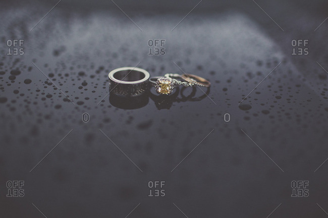 Wedding bands on wet surface