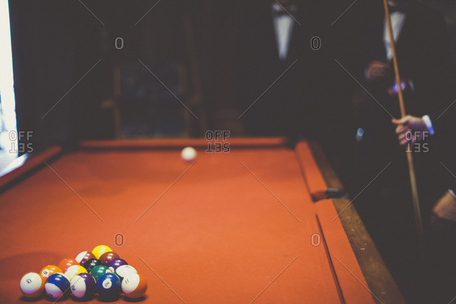 Men in tuxes playing pool