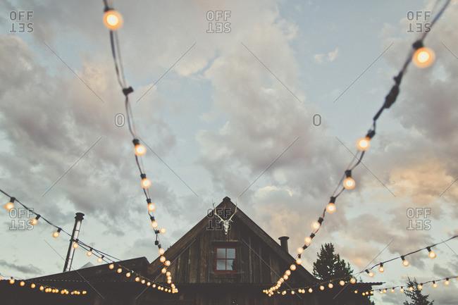 Wedding lights strung from cabin