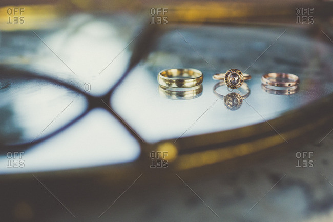 Wedding rings on reflective surface