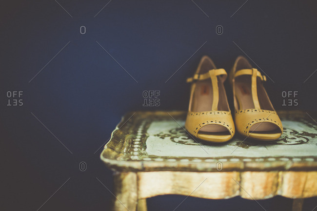 High heels on antique table