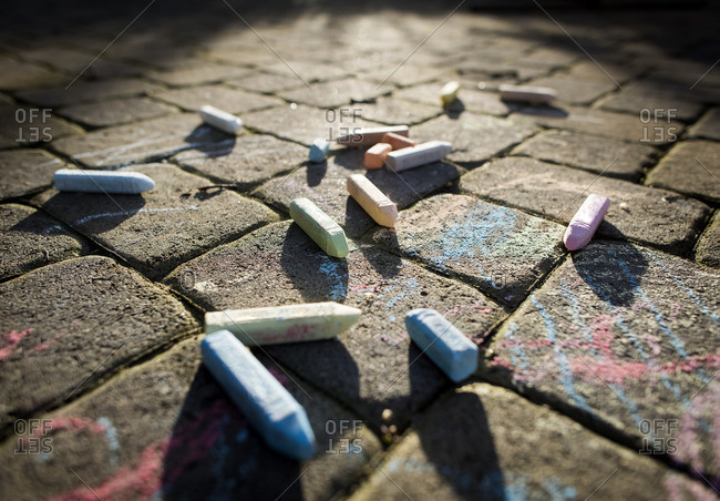Close-up of chalks on footpath