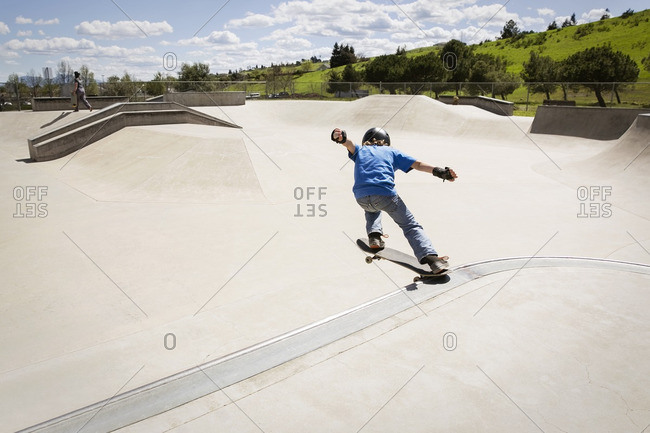 High angle view of boy performing stunt on skateboard ramp