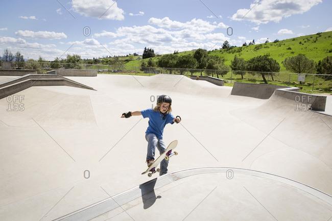 High angle view of boy skateboarding on ramp