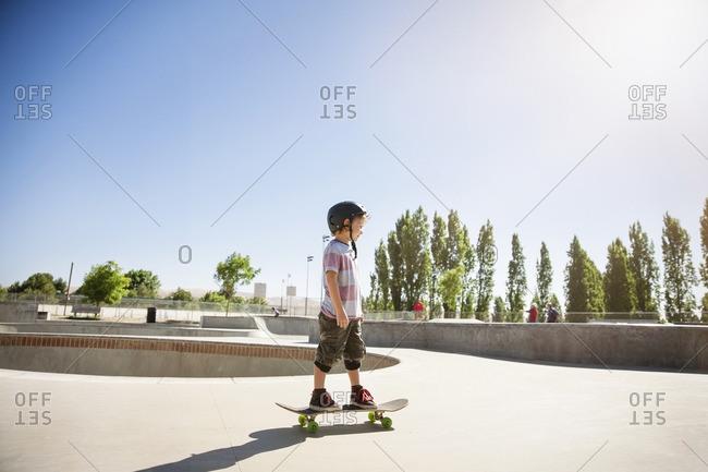 Side view of boy skateboarding on ramp