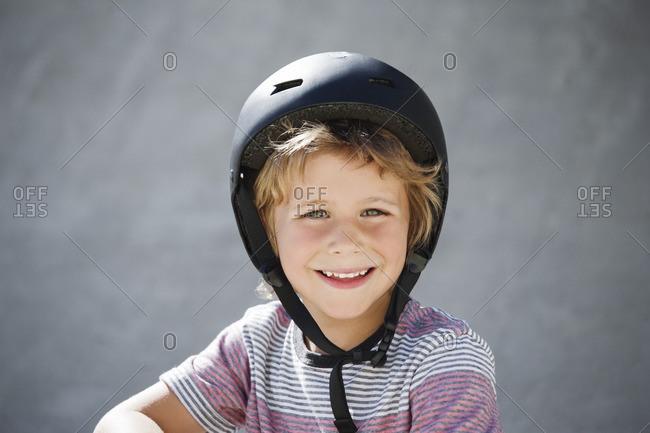 Portrait of happy boy at skateboard park