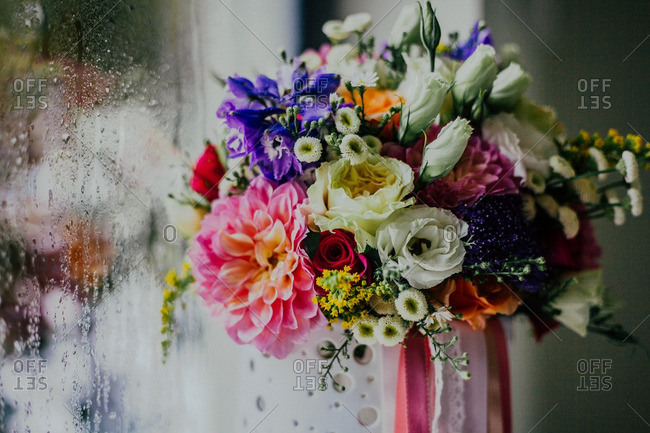 Bouquet of flowers against a window covered in condensation