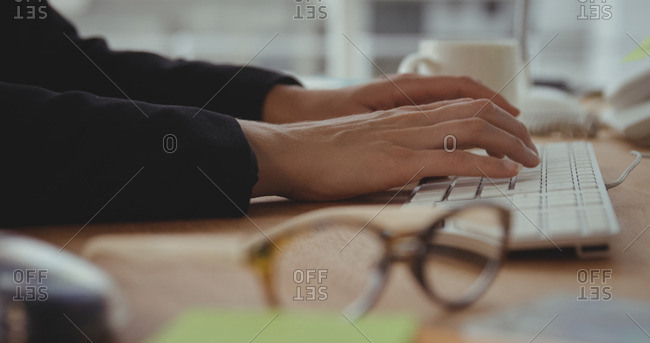 Close up of businesswoman hands is using a computer at the office