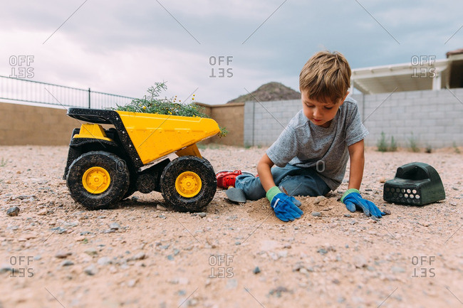 Boy digging up a plant