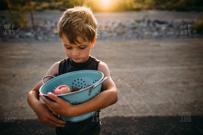 Child in desert with colander