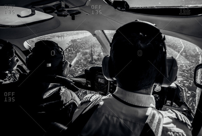 People over NYC in helicopter