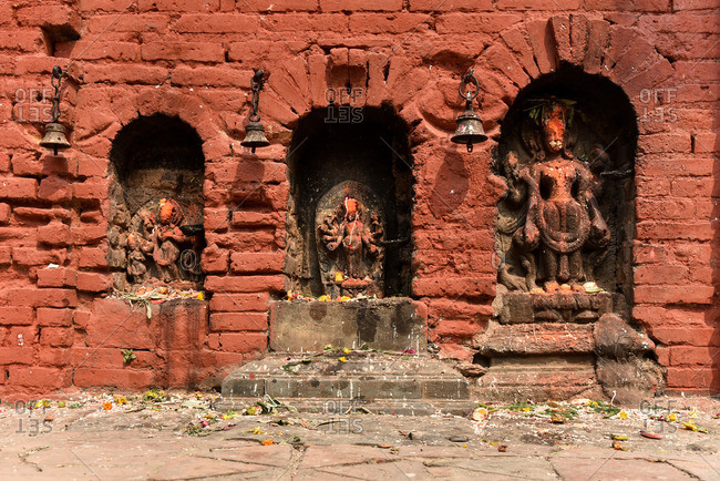 Statues of Hindu gods in wall